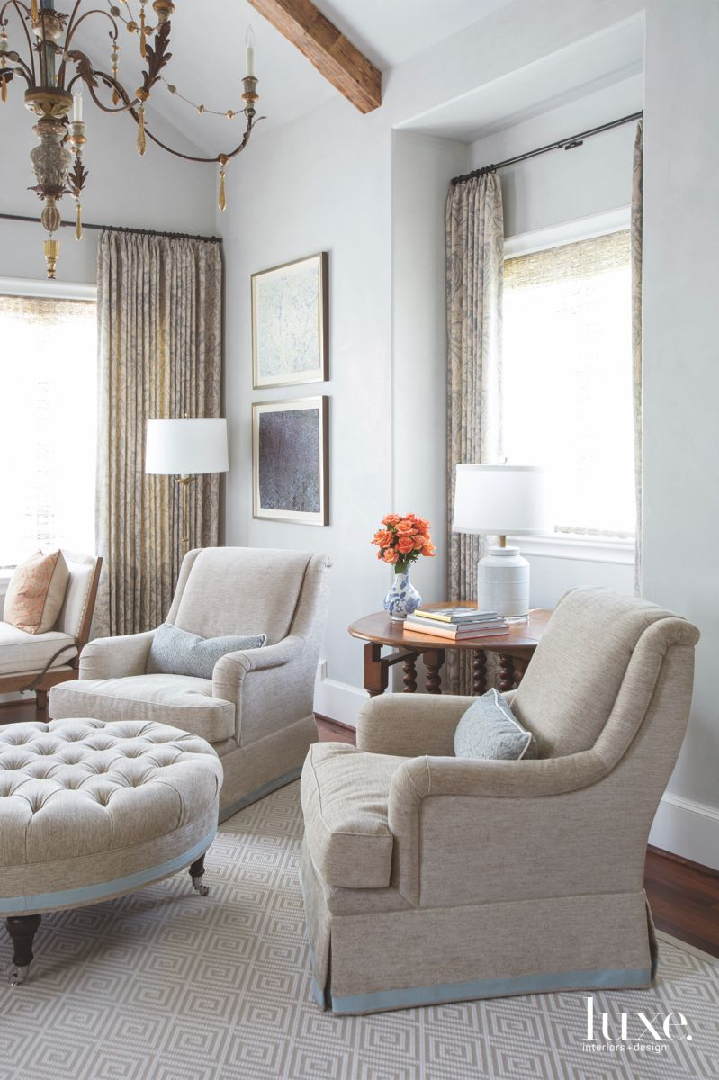 Blue Master Bedroom Sitting Area with Two Comfy Chairs and Traditional Ottoman