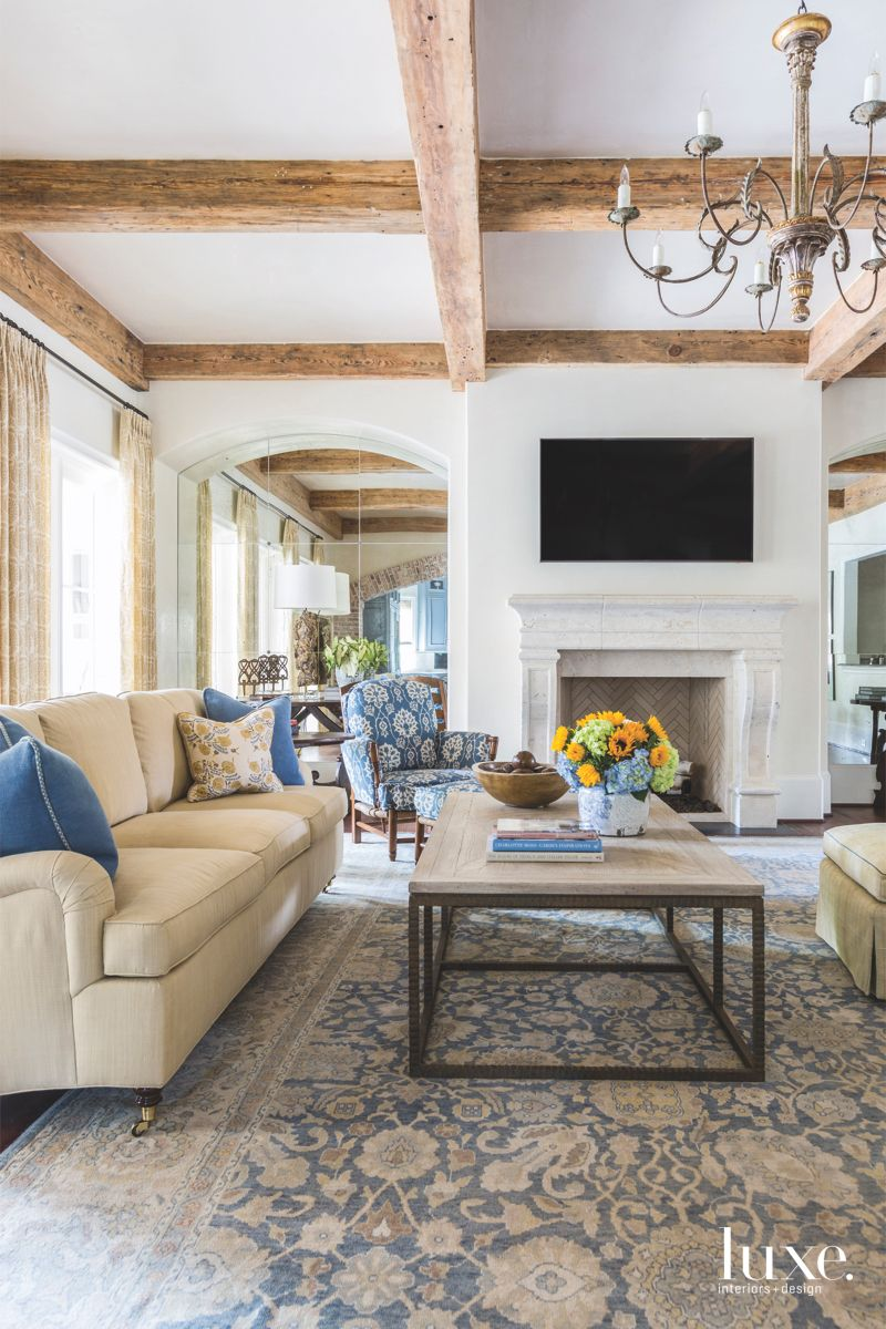 Grid Reclaimed Barn Wood Ceiling Living Room with Television, Fireplace, and Flowers