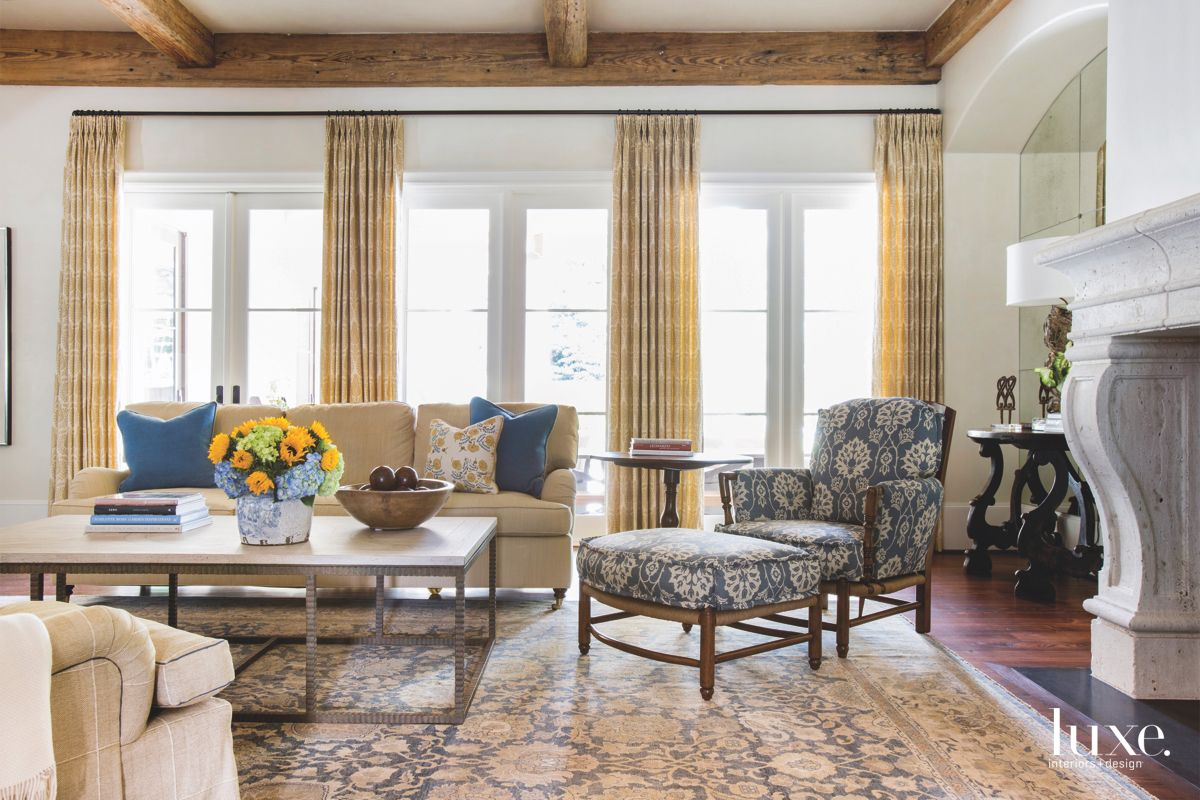 Patterned Rug and Chair Yellow Curtain Living Room with Marble Fireplace