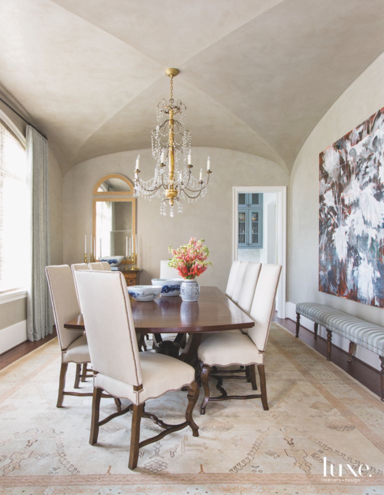 Arched Ceiling Dining Room With Abstract Art Painting And Chandelier