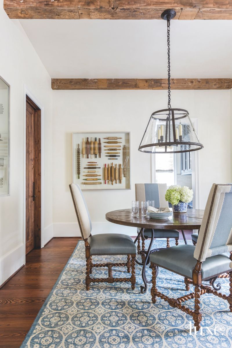 Rolling Pin Artwork Breakfast Room with Lantern Chandelier and Blue Fabric Accents