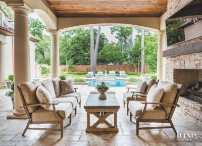 Patio with pool Grass Pool View Exposed Brick Covered Patio With Fireplace Television And Comfy Seating Fischer Landscape Restoration Pool View Exposed Brick Covered Patio With Fireplace Television And