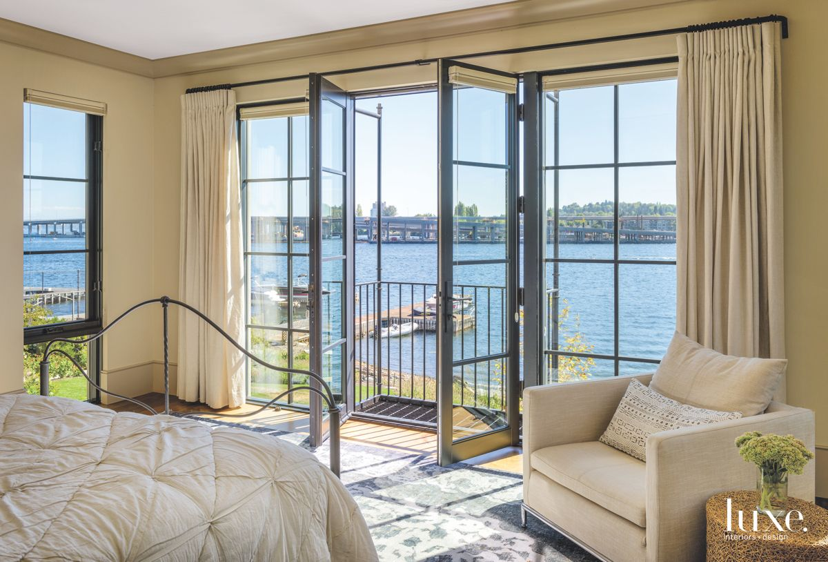 Windows for Walls in a Master Bedroom with a Water View