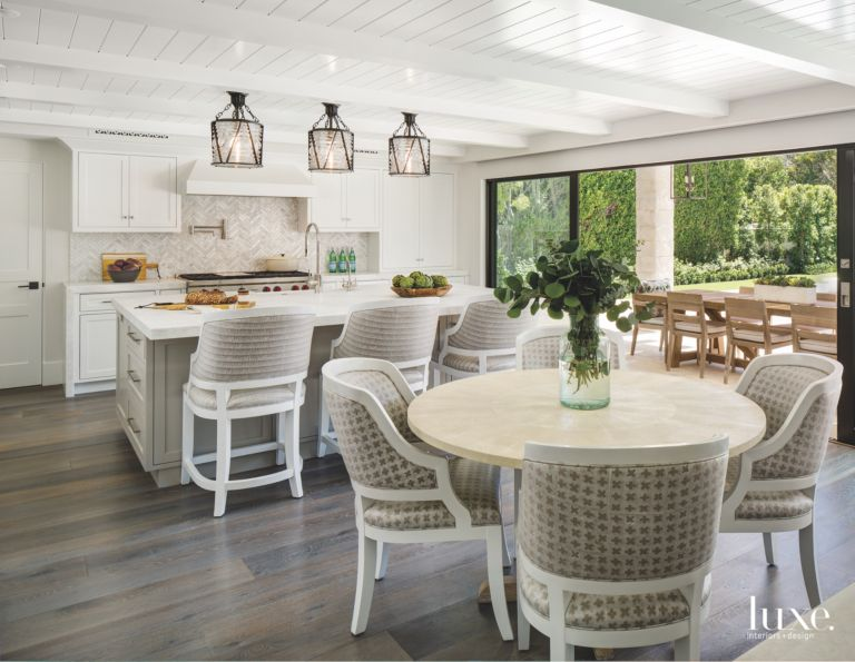 Open Flow Kitchen And Dining Table With White Siding Ceiling With