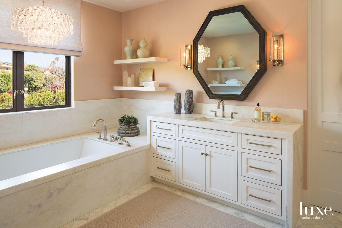 Peach Master Bathroom with Octogonal Mirror and Sleek Hardware