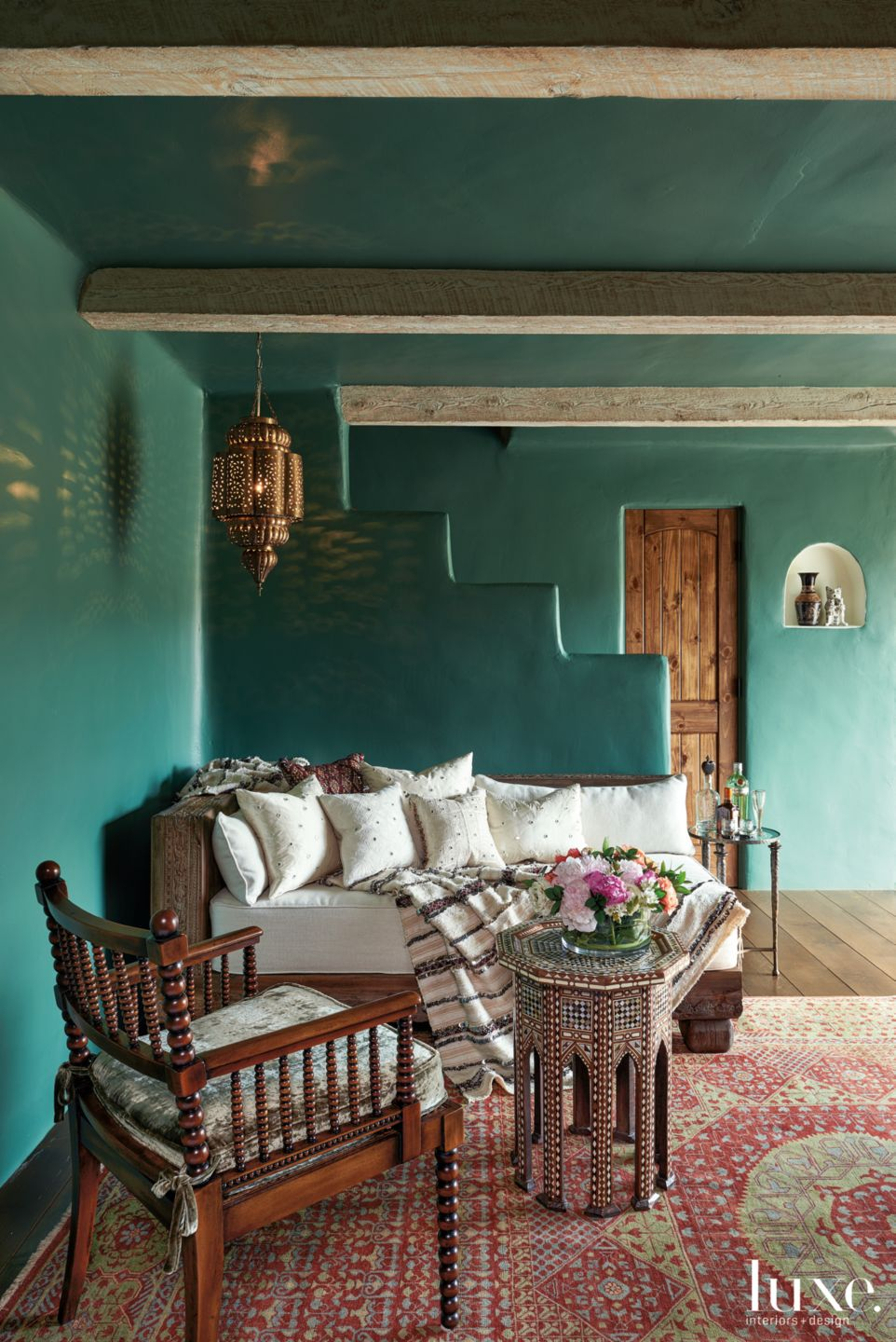 Mediterranean Green Media Room with Custom Antique Wood Chaise