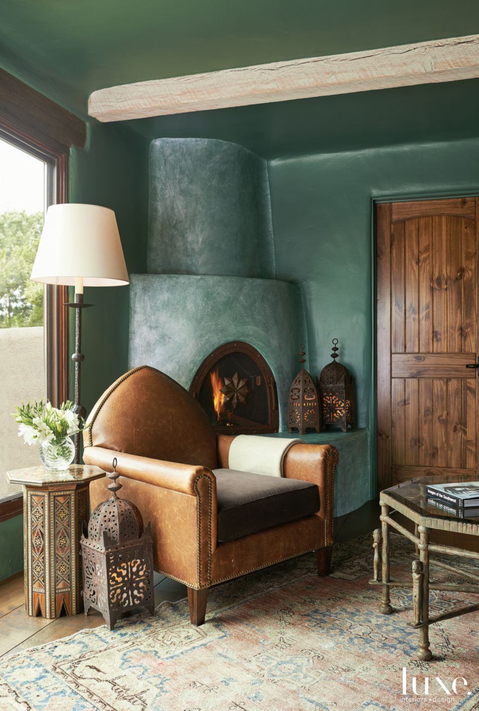 Mediterranean Green Seating Area with Abode Fireplace