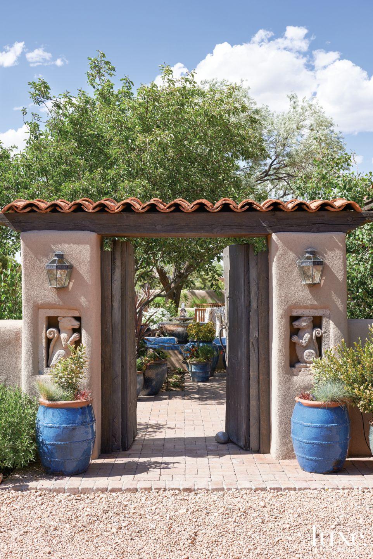 Mediterranean Neutral Outdoor Entry with Original Antique Doors