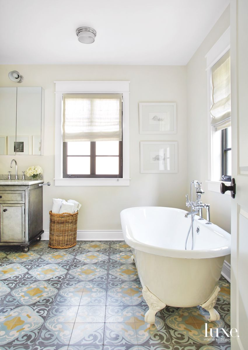Patterned Floor Tile Master Bathroom with Large White Soaking Tub