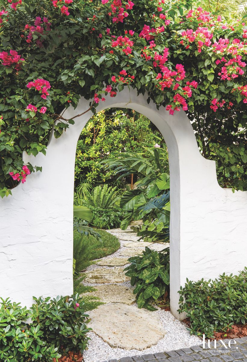 White Mediterranean Archway Path Covered in Flowers