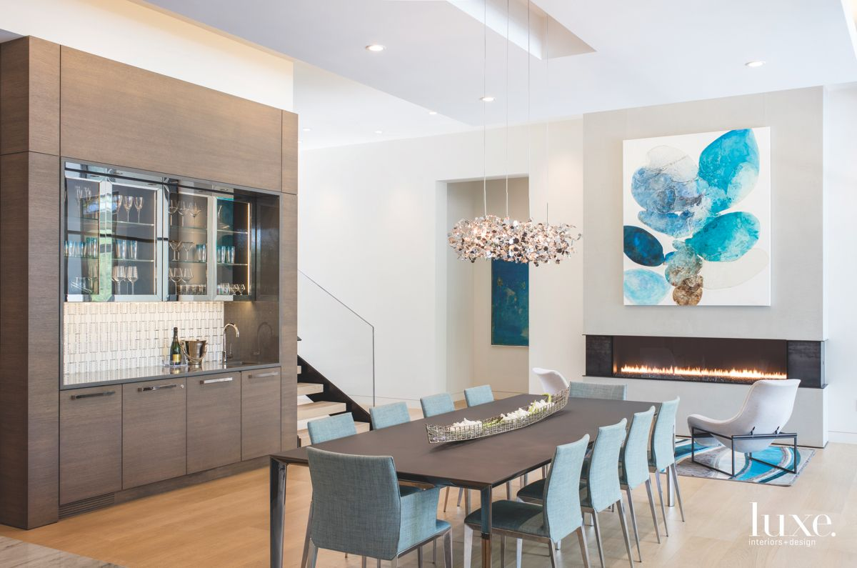 A Dining Room with Blue Touches and Fireplace