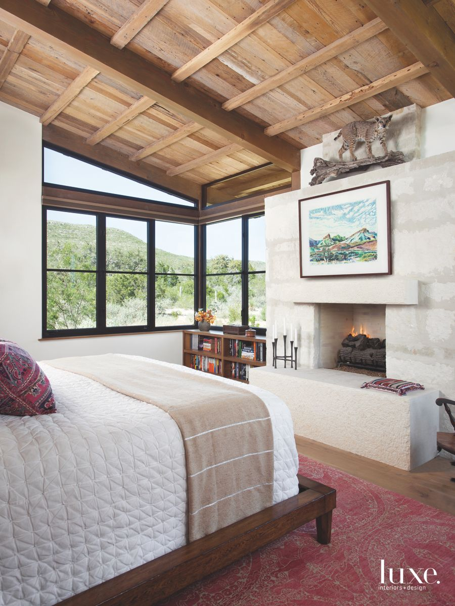 Animal Master Bedroom with Landscape Painting and Fireplace
