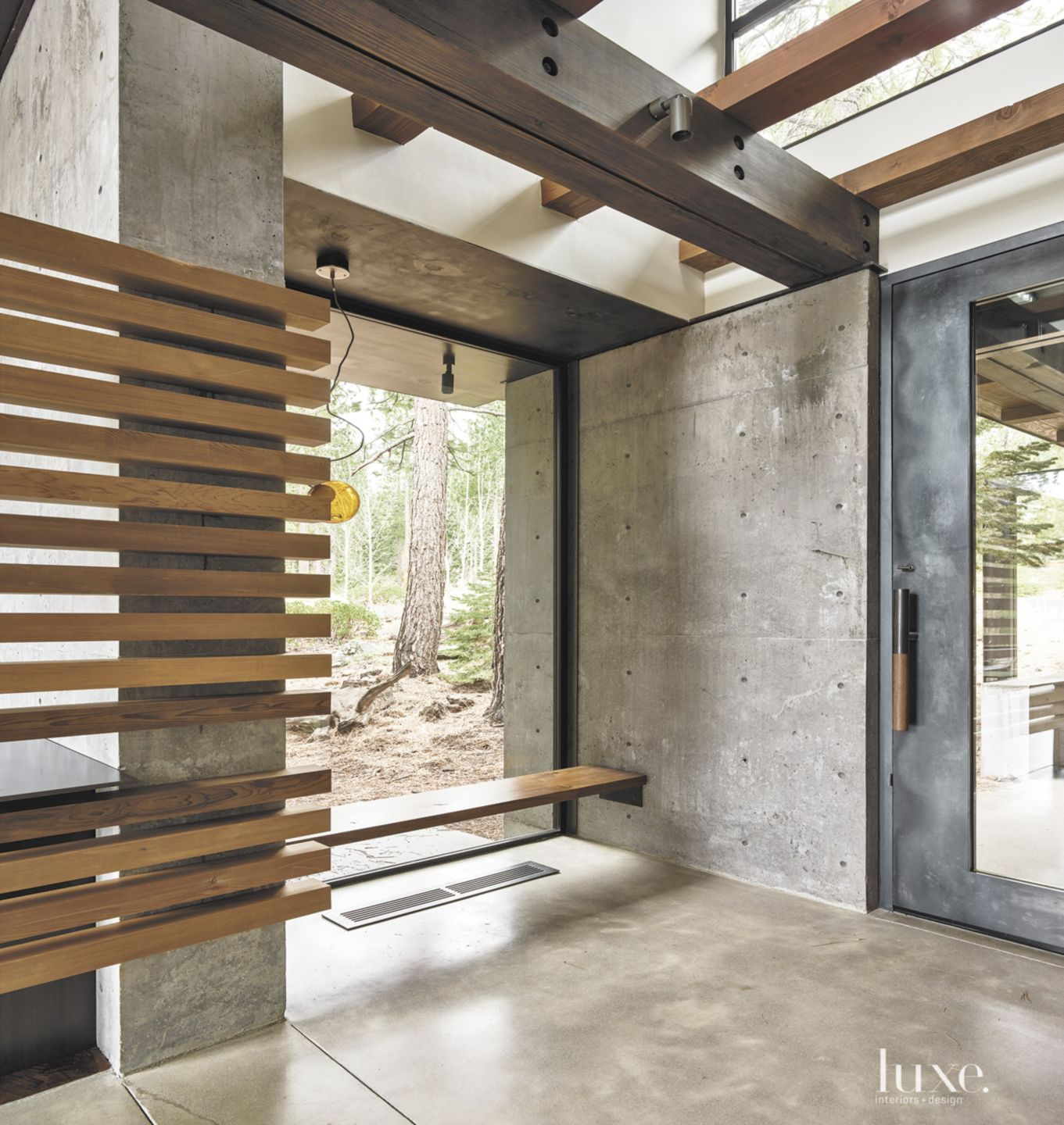Contemporary Neutral Foyer with Blow Glass Light