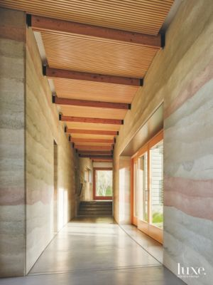 Curved Rammed Earth Walled Hallway & Curved Rammed Earth Walled Hallway - Luxe Interiors + Design