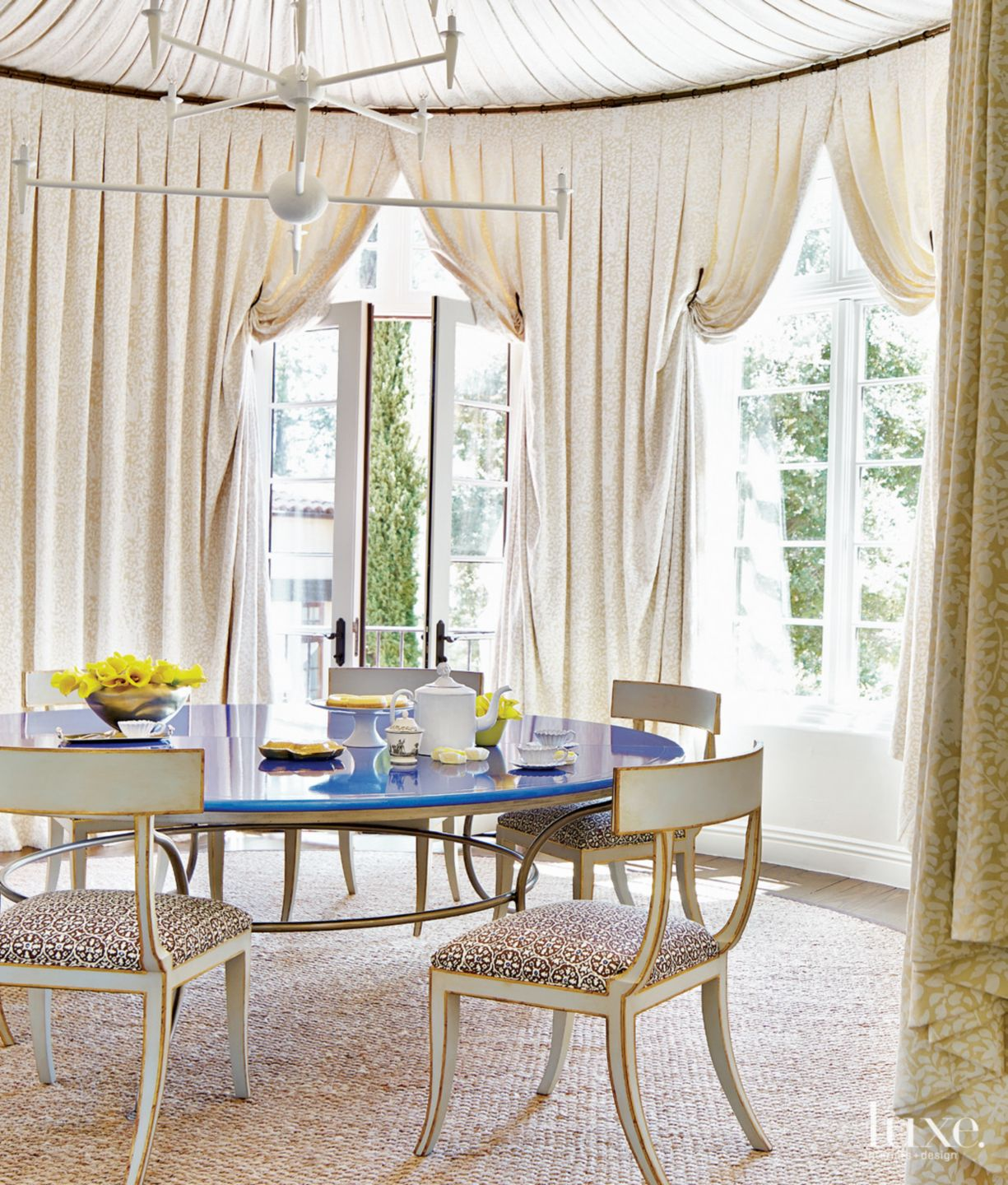 Contemporary Cream Dining Room with Lava Stone Top Table