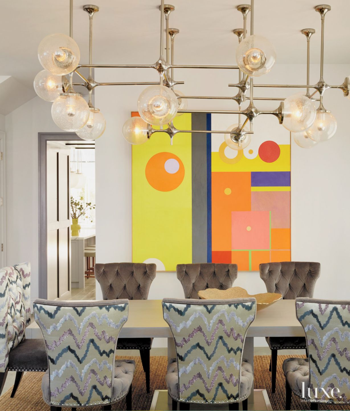 Eclectic Multi-Colored Dining Area with Vintage Light Fixture