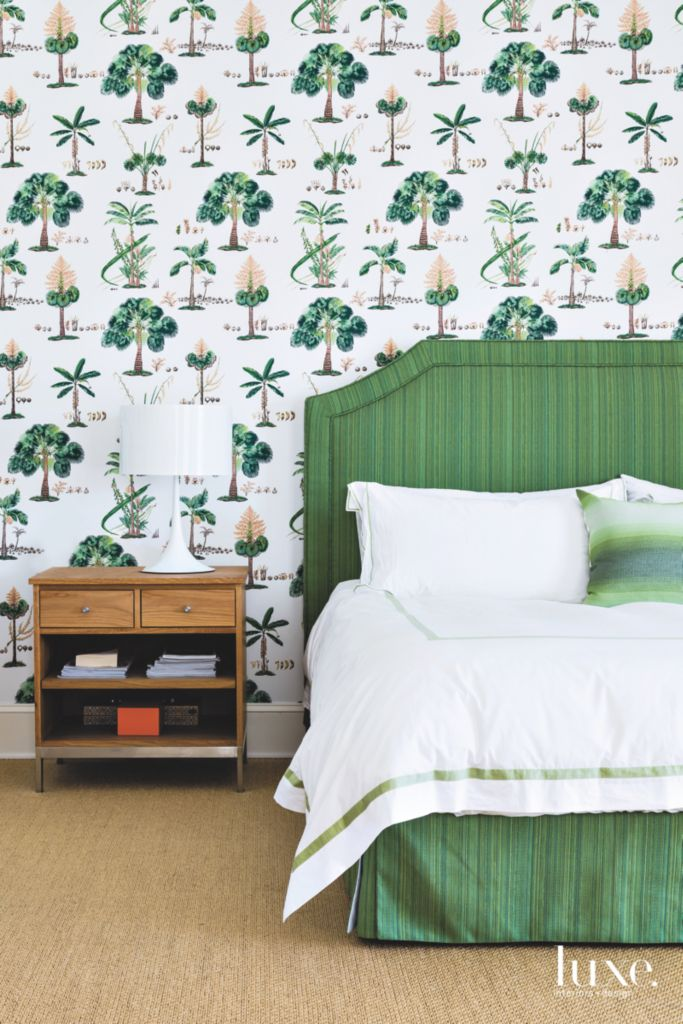 florida tropical green vibe master bedroom with tree wallpaper