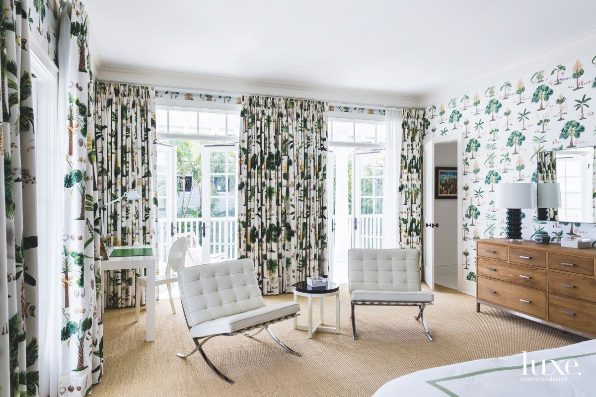 Iconic Seating Master Bedroom with Patterned Wallpaper and Curtains with Wooden Dresser