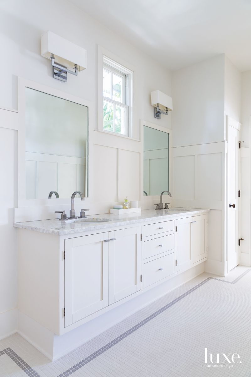 Completely White Master Bathroom with Twin Mirrors and Windows