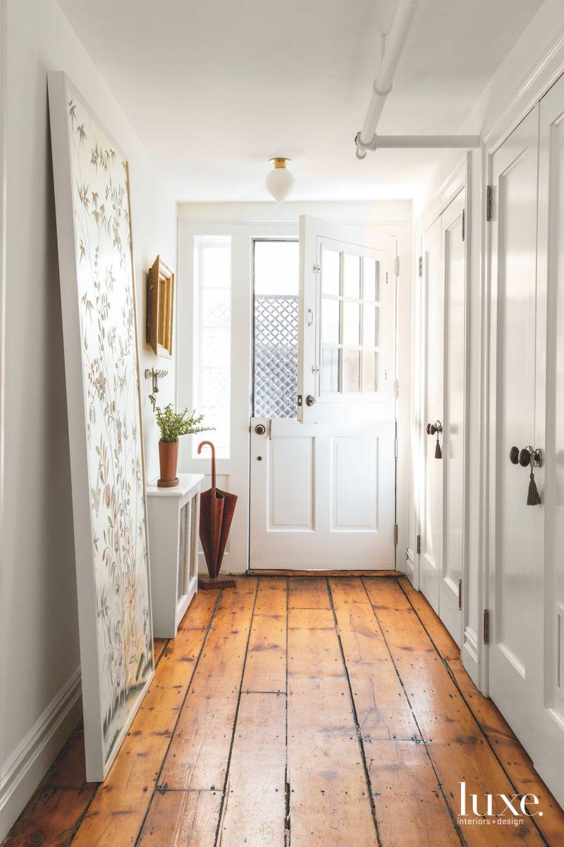 Dutch Door Entryway with Wooden Floor and Floral Panel