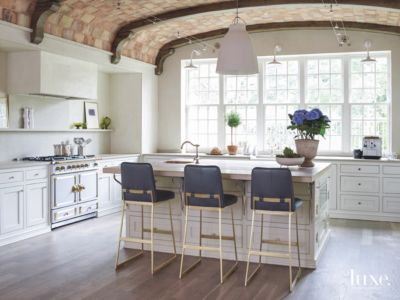 Brick Curved Kitchen Ceiling With White Cabinets, Island, Bar Stools, And  Lighting