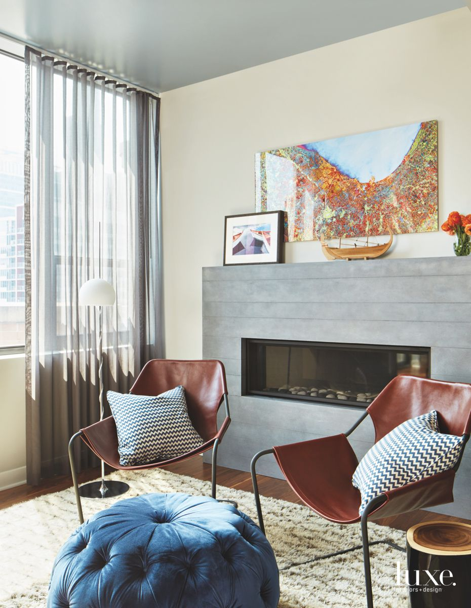 Custom Concrete Fireplace with Leather Armchairs