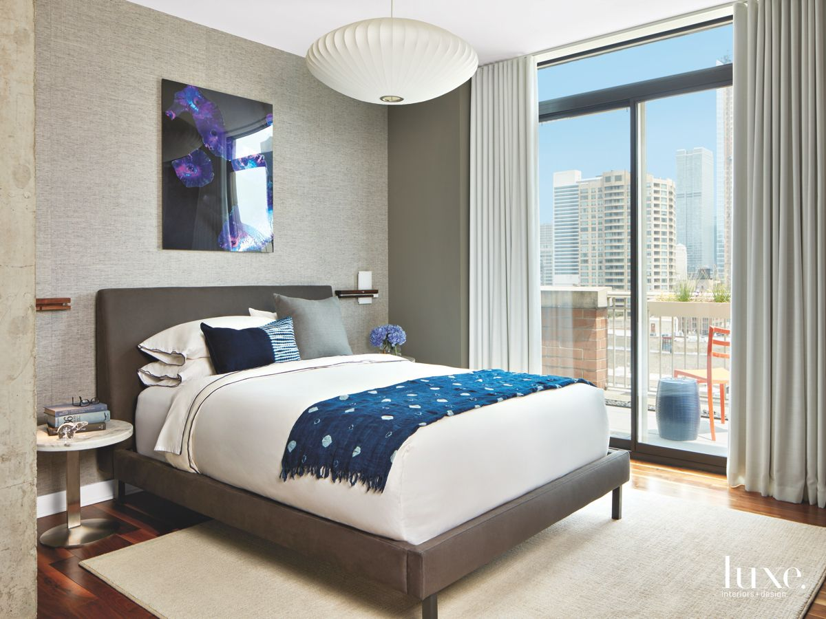 Gray Variations Master Bedroom with Wall Art and Chicago Skyline View