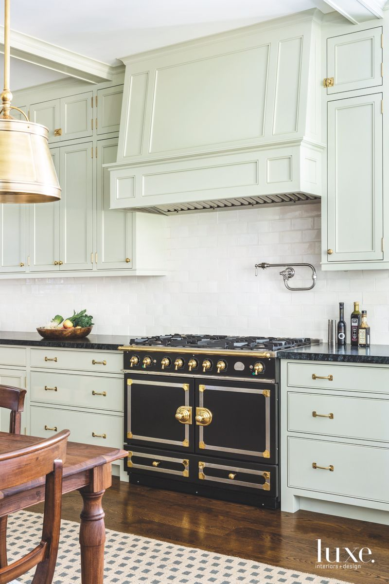 Black Kitchen Range Contrasting Light Green Cabinets Luxe