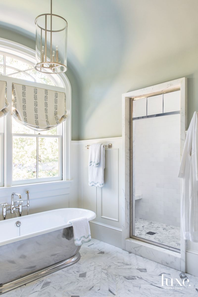 Master Bathroom with Subway Tile and Chandelier
