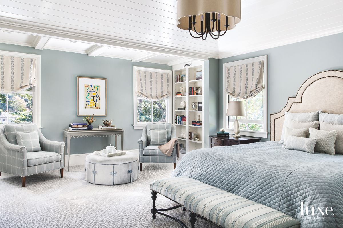 Reupholstered Armchairs, Bench, and Chandelier Decorate a Master Bedroom