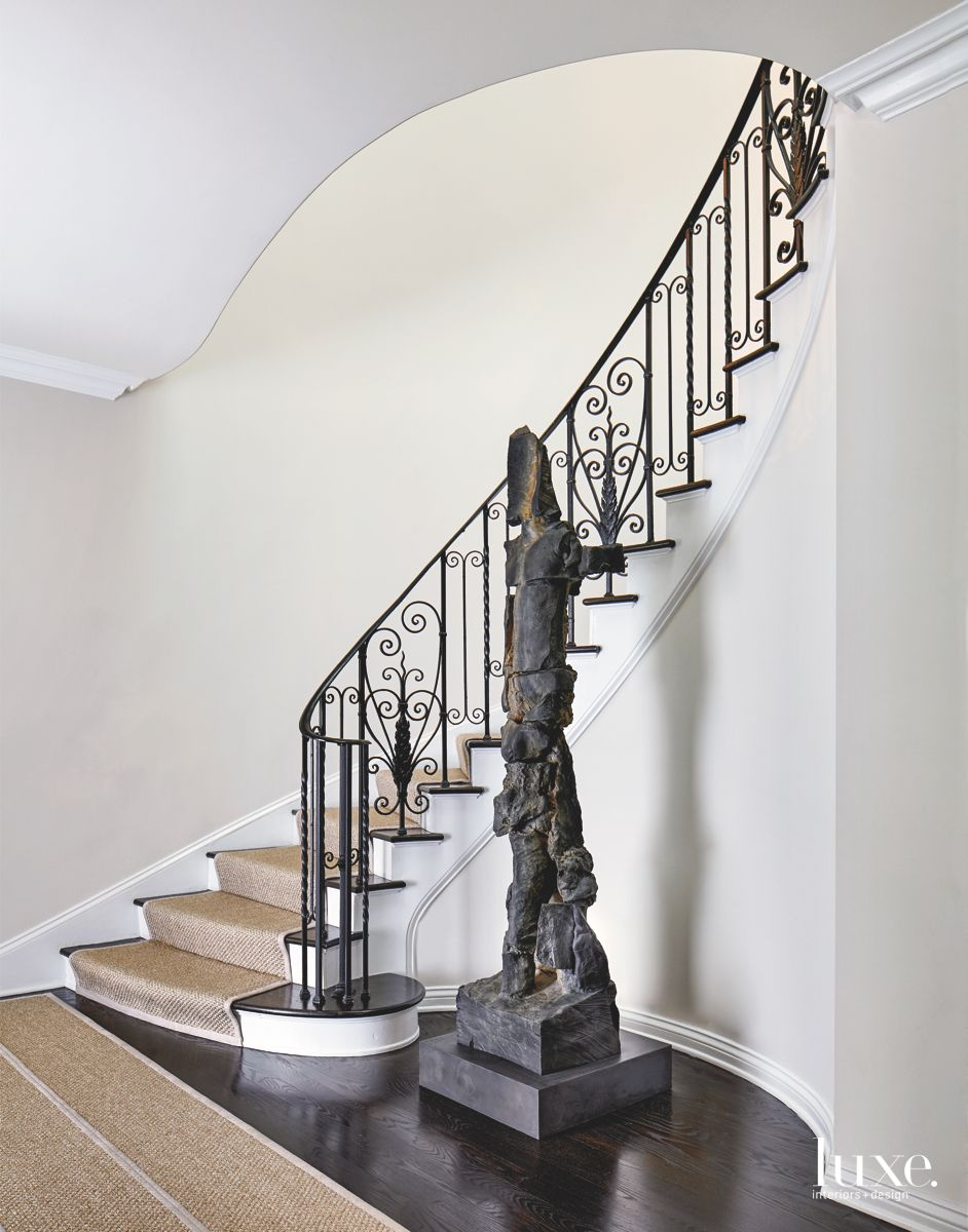 Stairway Entrance with Bronze Art and Area Rug