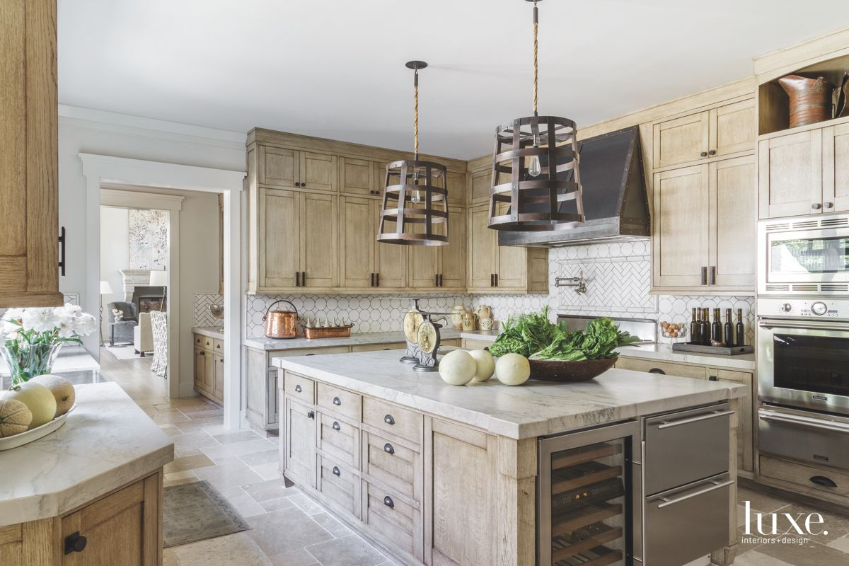 Iron Chandelier Cover Kitchen with Wooden Cabinets Wine Cooler and Copper Accessories