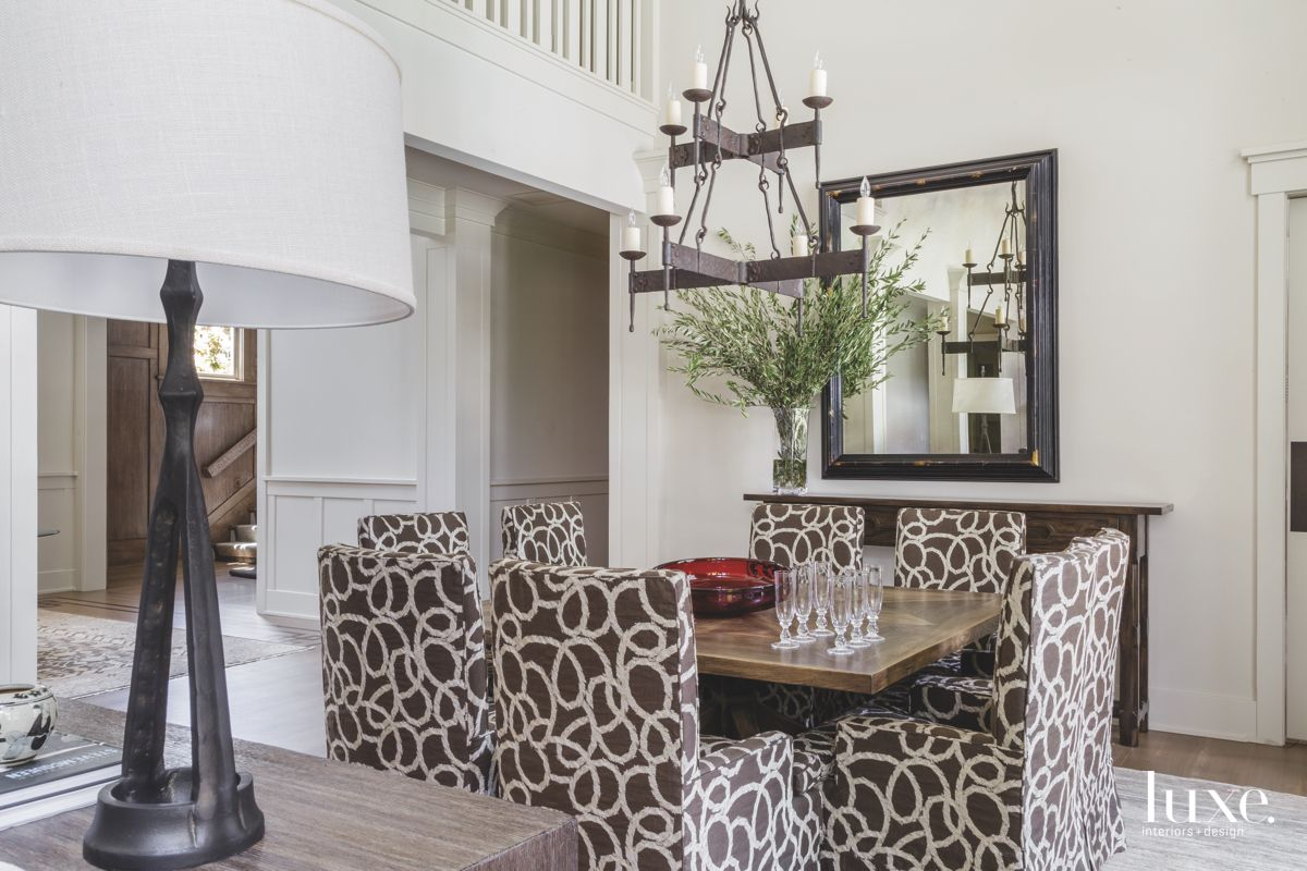 Brown Spiral Dining Room Chairs with Iron Chandelier and Mirror