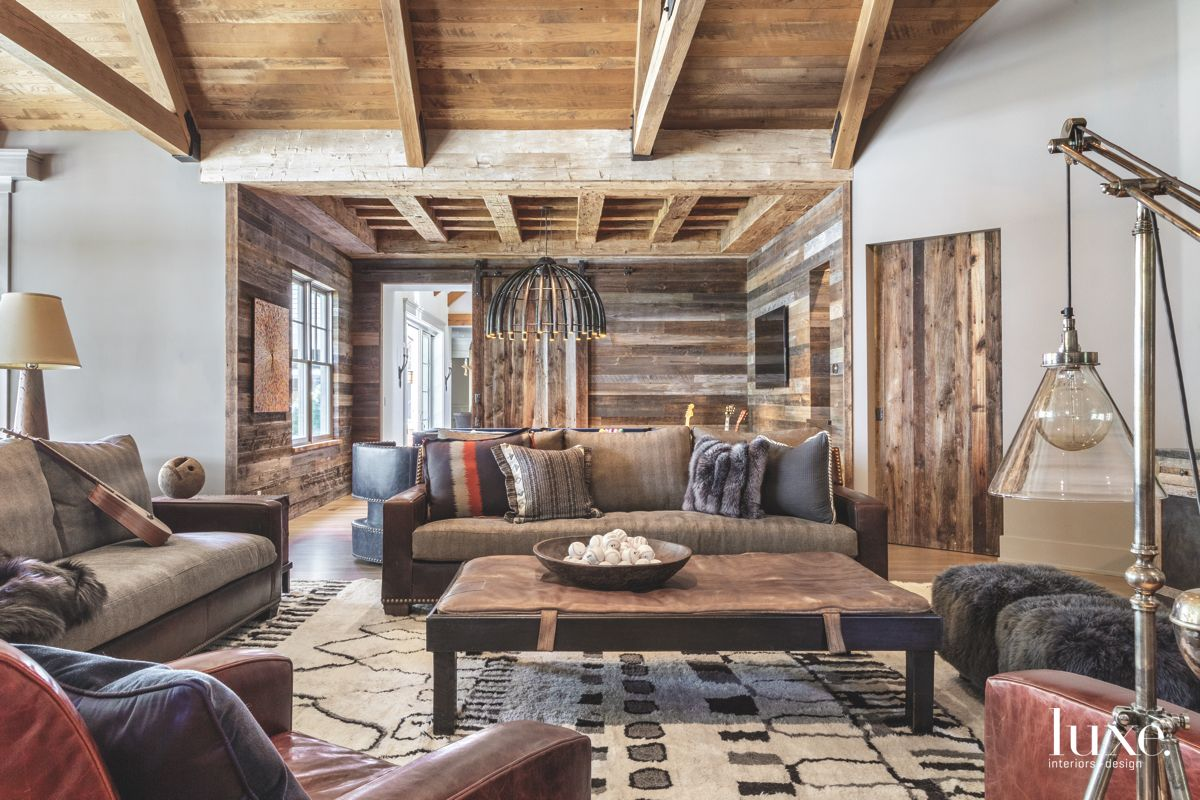 Wooden Sitting Area with Vaulted Ceiling Fuzzy Ottomans and Rug