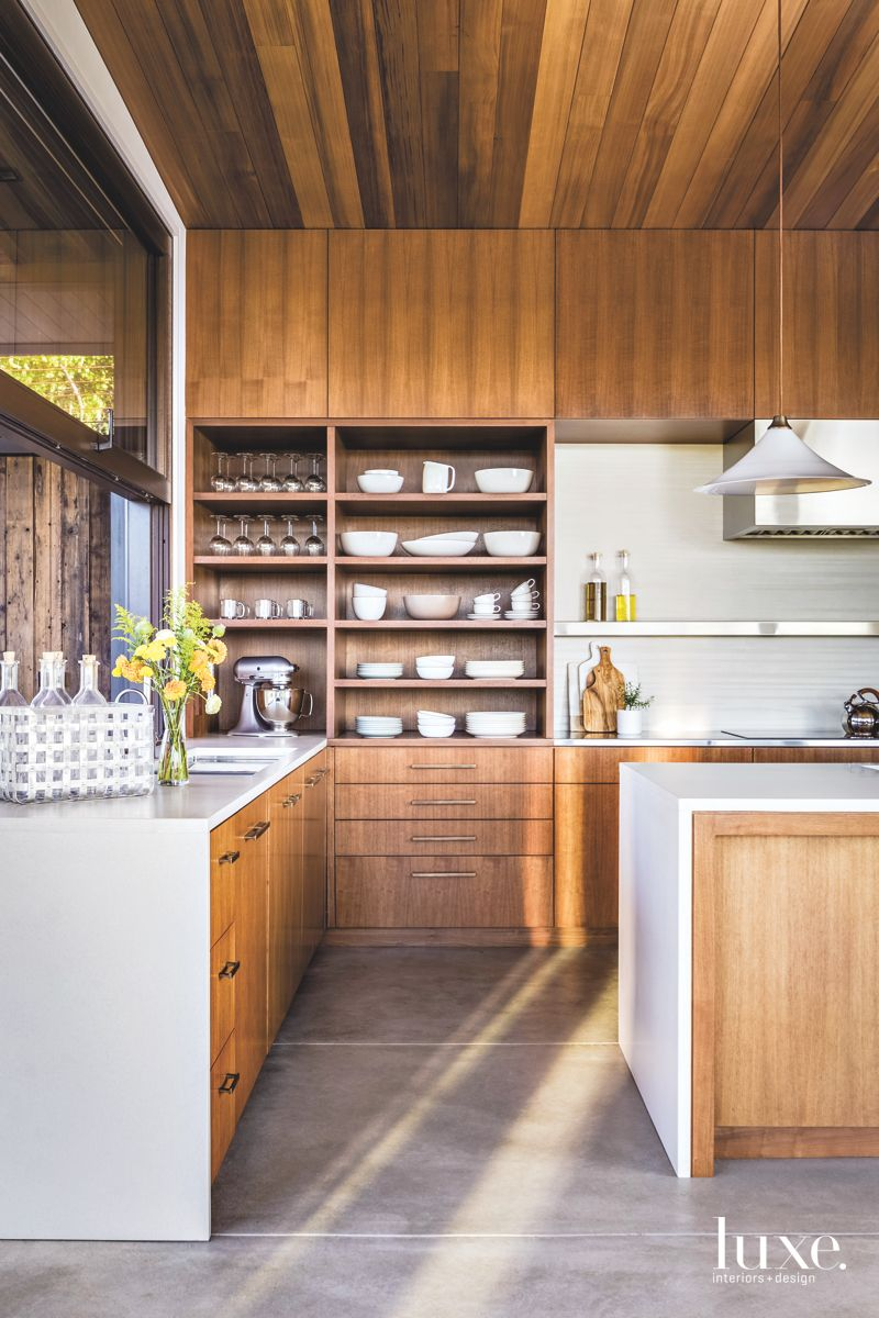 Walnut Cabinetry Kitchen with Pendant Shades