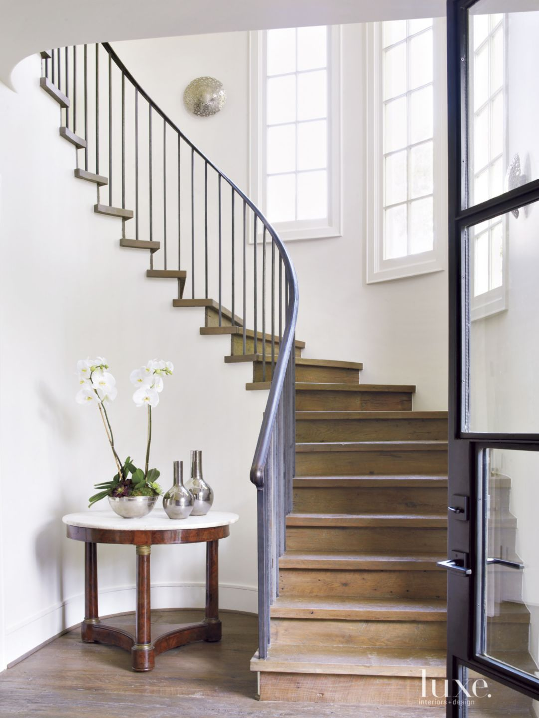 Transitional White Staircase with Reclaimed-Oak Plank Flooring