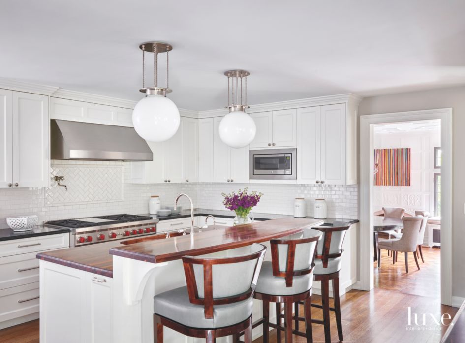 Shaker Style All White Kitchen With Spherical Pendant
