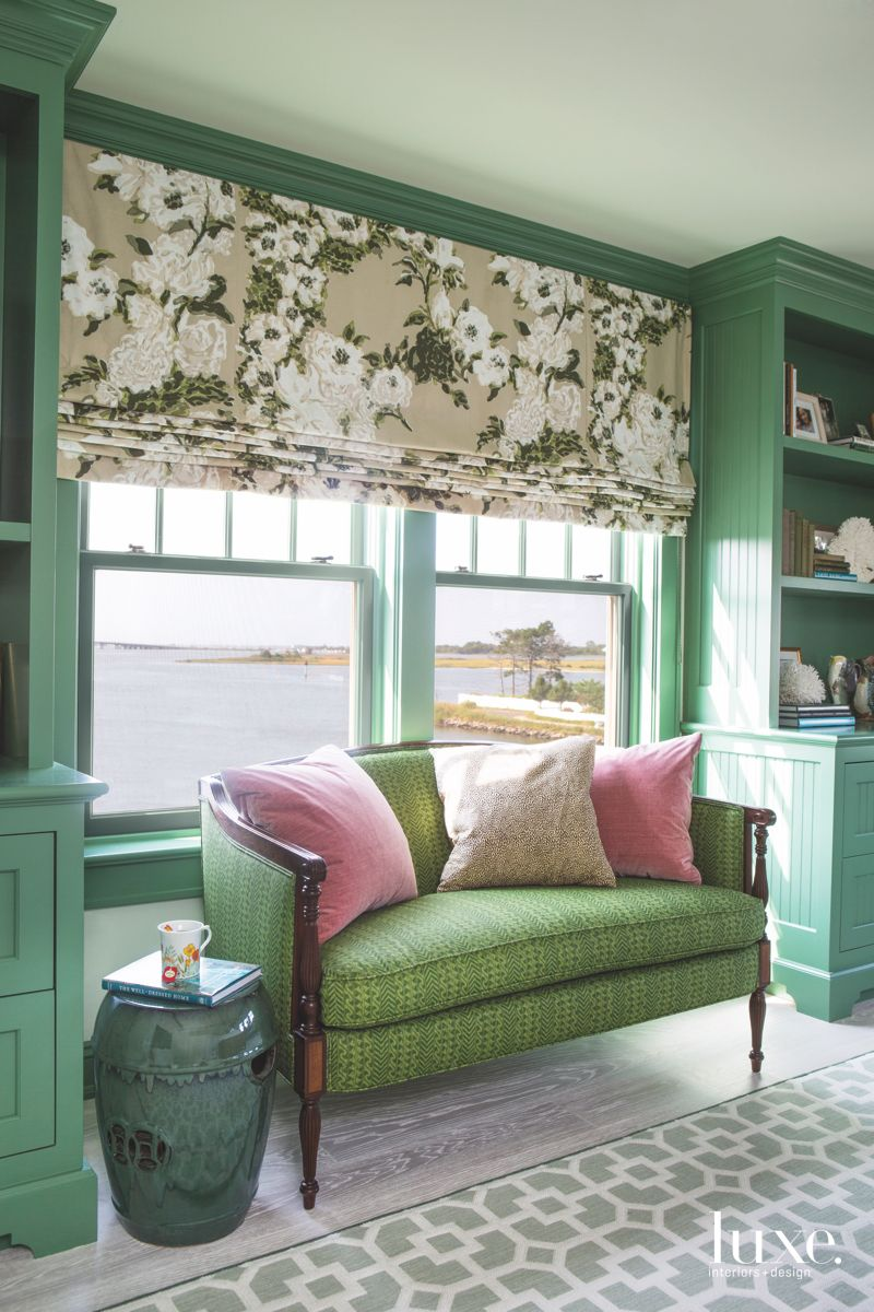 Green Master Suite with Floral Shades and Storage Overlooking Water