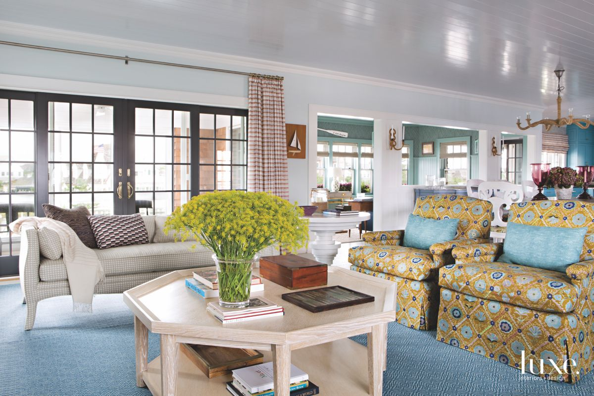 Eclectic Blue and Yellow Living Room with Flowers, Sofa and Table