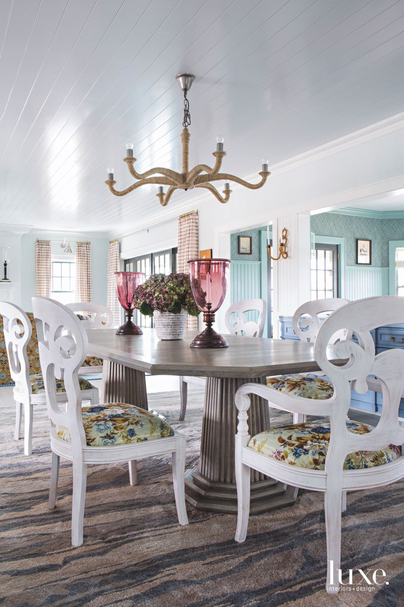 Nautical Blue Dining Room with Chandelier and Wood Patterned Rug