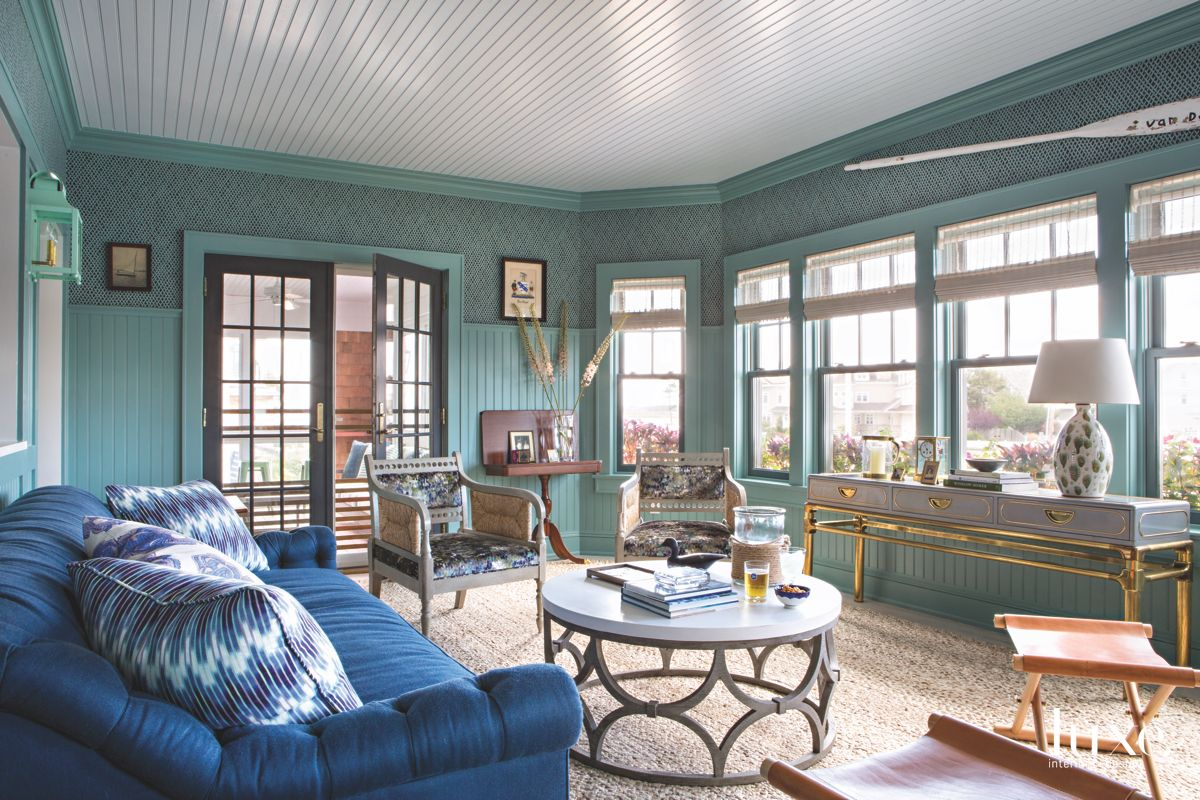Teal Sun Room with Shiplap Ceiling, Blue Sofa and Antique Looking Furniture
