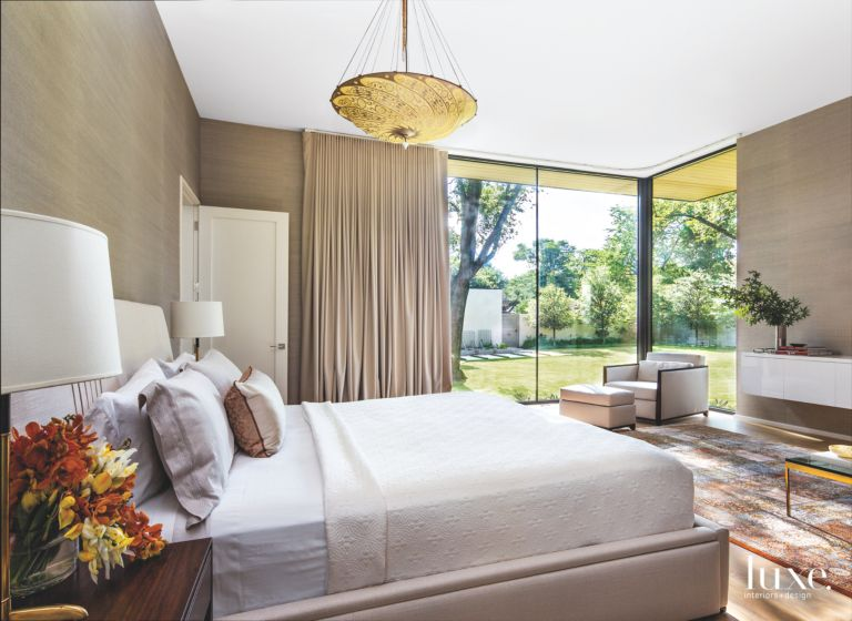 A Master Bedroom With A Corner Window Luxe Interiors Design