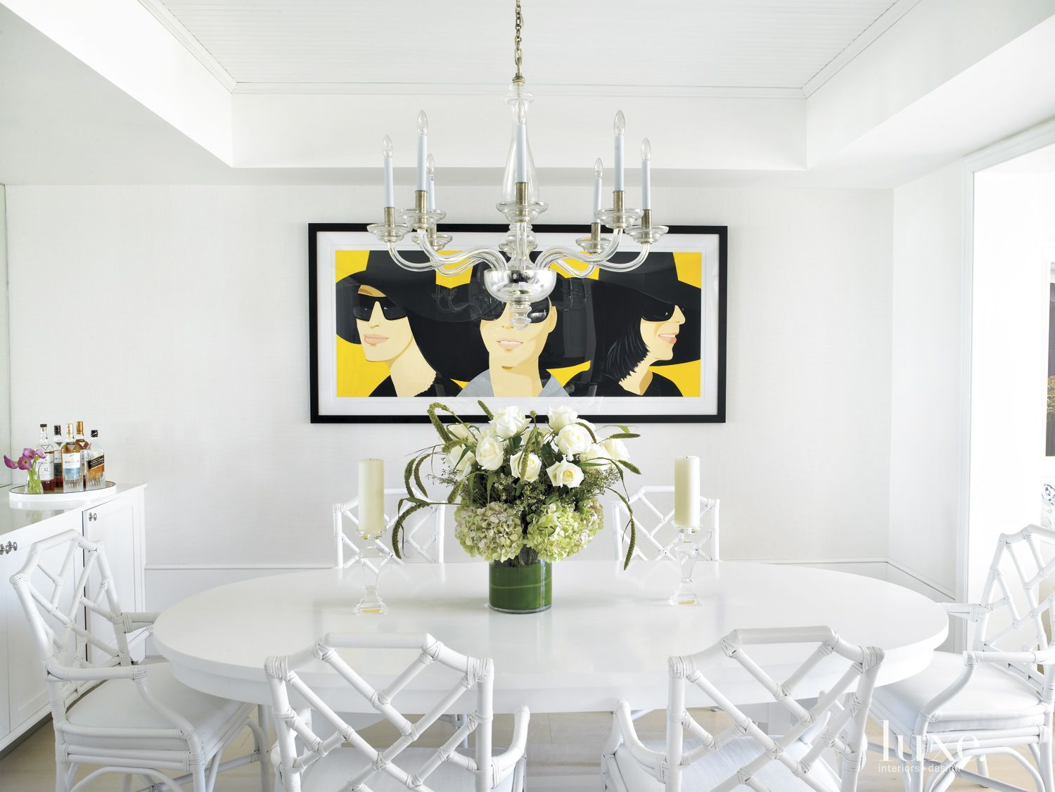 Modern White Dining Room with Yellow Artwork