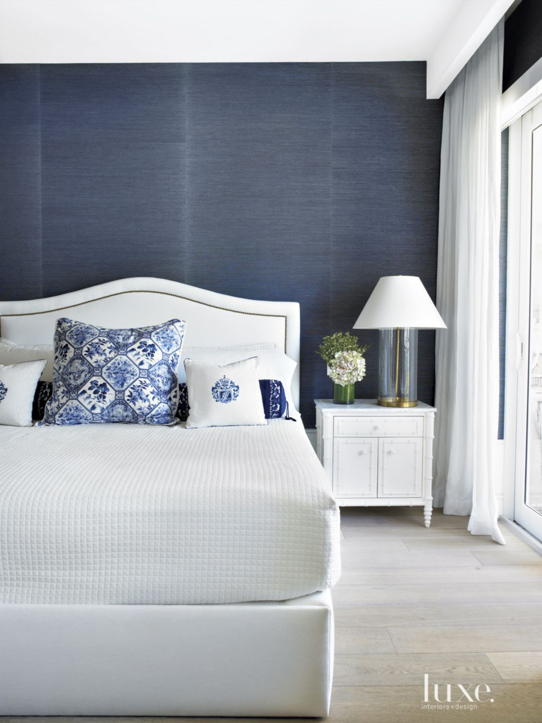 Modern Blue Bedroom with White Bed