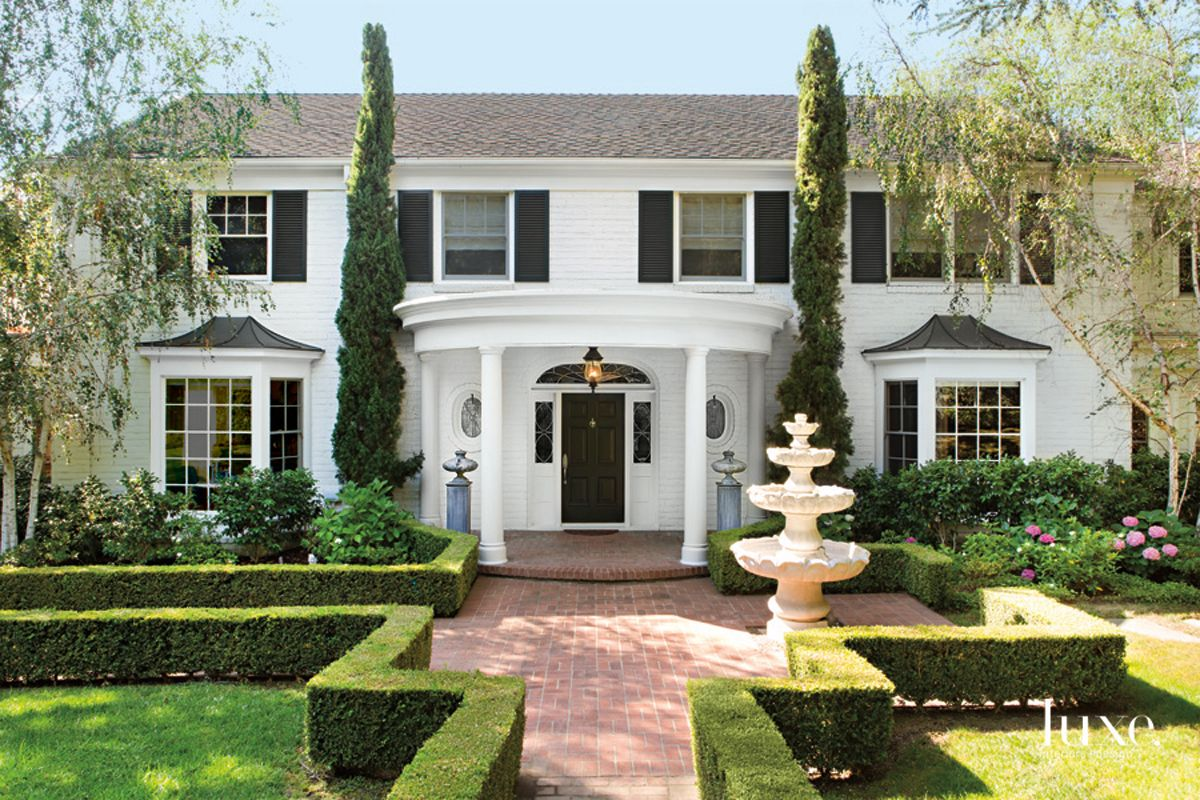 Traditional White Front Elevation with Stone Fountain